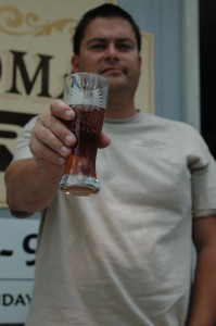 Little Yeoman brew master Chad Frederick holds up a glass of his Little Yeoman Pale Ale.